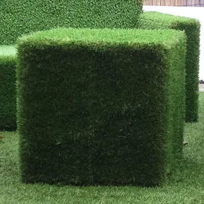 Artificial grass covered cube